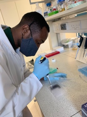 Picture of Fiyin working in a lab