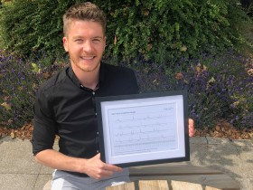 Picture of Matthew holding a certificate